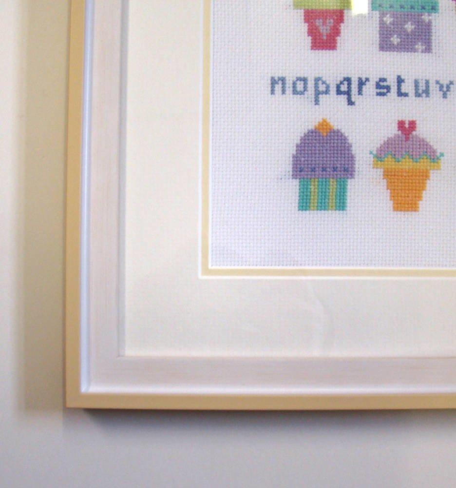 Newborn cross stitch framed