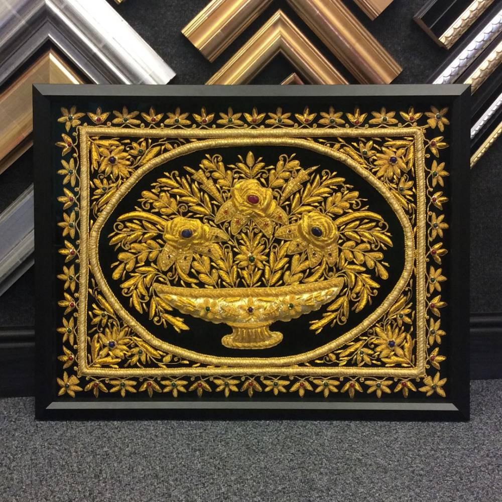 A simple yet sophisticated black frame is all that is needed to complement this vibrant piece of intricate work