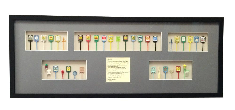 Finished product - cocktail sticks framed in black frame