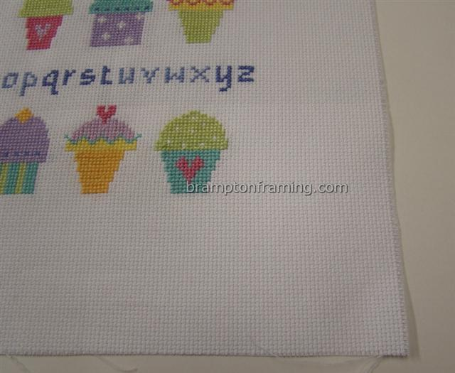ironed cross stitch ready to frame